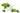Weiße Porzellanschale mit weißem Moerser und frischen gruenen Melisseblaettern