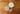 zwei glaeser mit haferflocken und milch mit loeffel auf holztisch