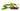 Einige dunkelbraune jojobafruechte mit einem Jojobastrauch mit gruenen Blaettern und gelben Blueten auf weißem Hintergrund