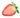 In der Mitte aufgeschnittene Erdbeere mit gruenen Blaettern auf weißem Hintergrund in Nahaufnahme